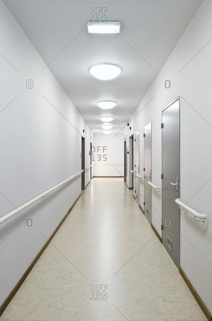 Doors lining a well lit hallway