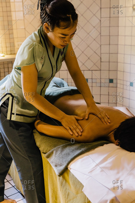 Thailand - December 19, 2014: Therapist giving oil massage to guest at spa