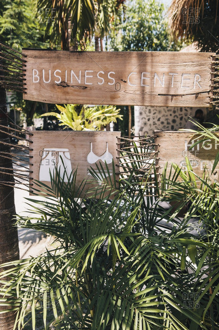 Wooden sign at digital business center with picture of swimwear