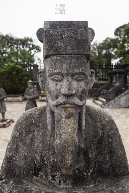 Stone carved sculpture mandarin outside entrance to Imperial Tombs of the Nguyen Dynasty
