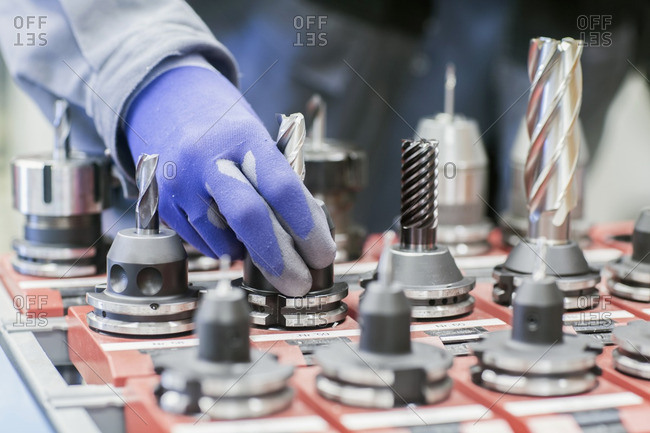 Engineer hand operating at drill bit in an industrial plant, Freiburg im Breisgau, Baden-Wurttemberg, Germany