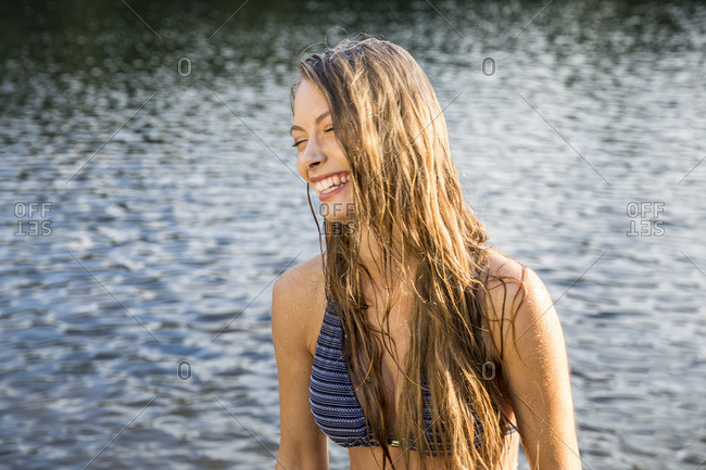 Laughing young woman in a lake