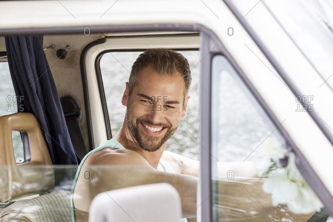 Smiling man in van