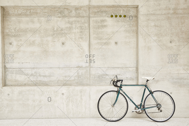 Bicycle at concrete wall