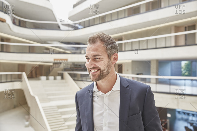 Smiling businessman in office building