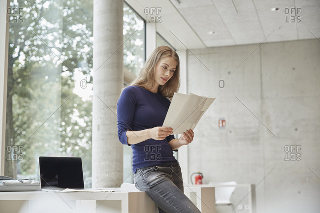 Young woman looking at documents