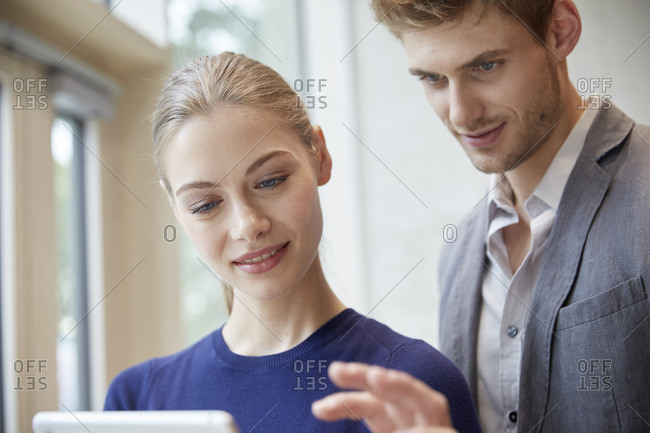 Young man and woman sharing tablet