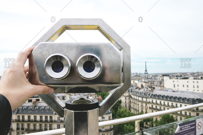 France, Paris, binoculars with the city and the Eiffel Tower in the background