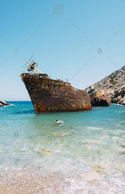Greece, Cyclades Islands, Amorgos, Man swimming to visit the shipwreck, Olympia