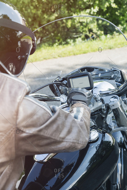 Man starting his motorbike, partial view