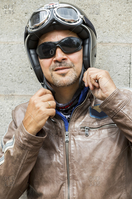 Portrait of biker wearing sunglasses and helmet