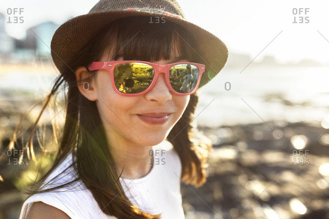 Portrait of a smiling girl on the beach at sunset