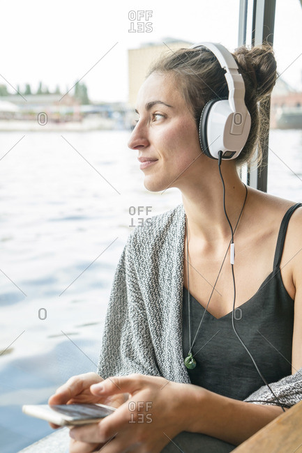 Relaxed woman listening music with headphones