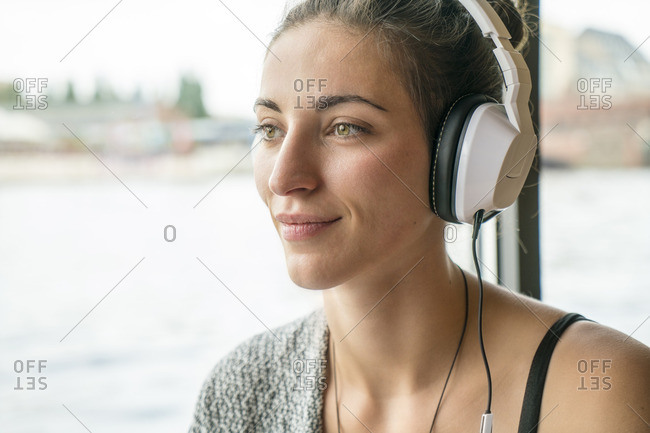 Portrait of relaxed woman listening music with headphones