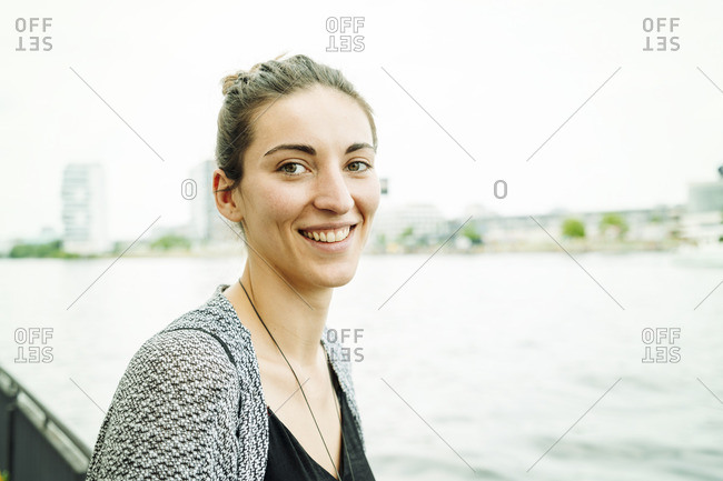 Portrait of smiling woman at riverside