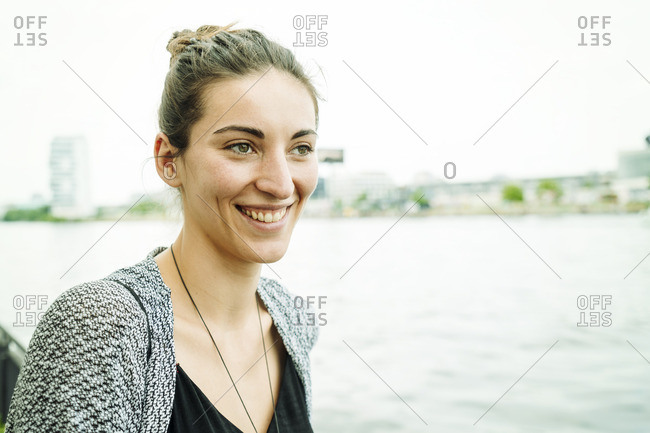 Portrait of smiling young in front of river