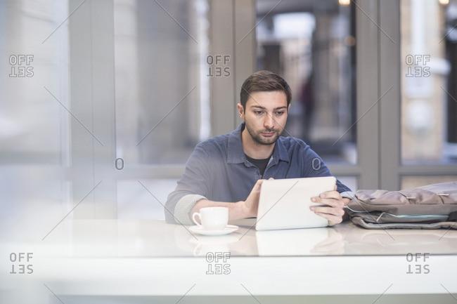Man using digital tablet at office desk