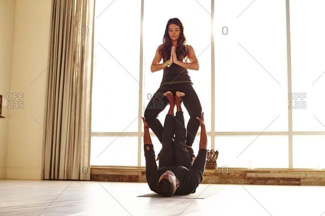 Man And Woman Doing Yoga In Studio Setting