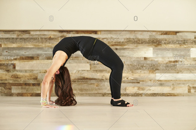 Young Woman Doing A Backbend In Studio