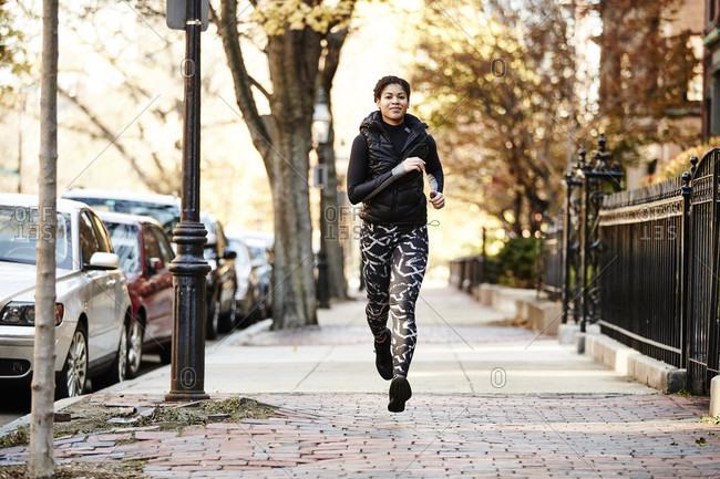 Athlete Woman Running On Street In Boston