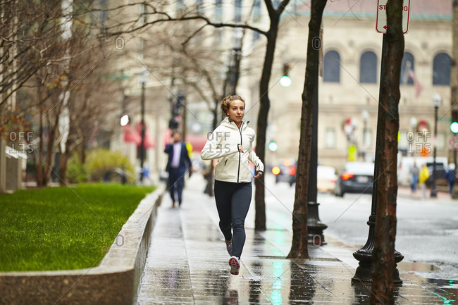 Young Woman Running On Street In Boston