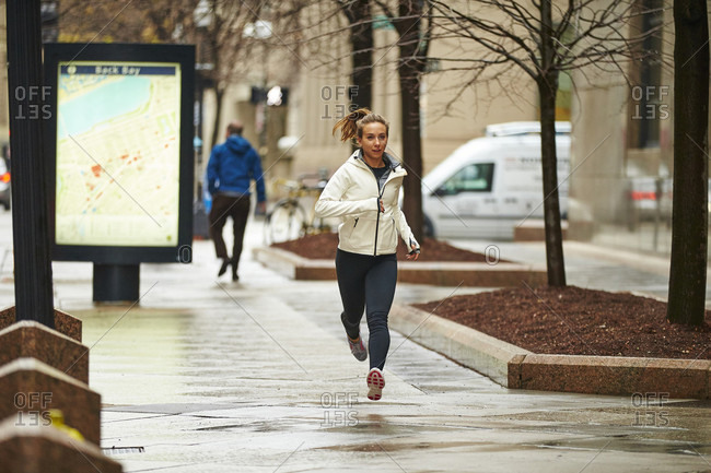 A Female Runner Running Through The Streets Of Boston