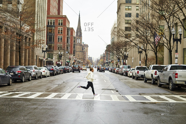 Female Athlete Jogging On Street Of Boston City