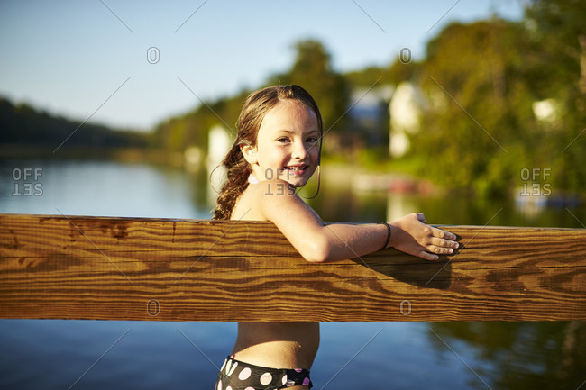 Smiling Girl Leaning On Footbridge At Vermont