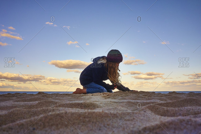 Young Girl Playing On Sand