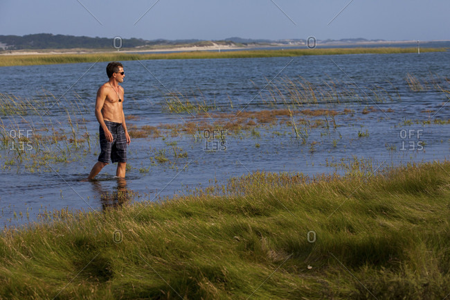 Man Standing At Hatches Harbor In Provincetown