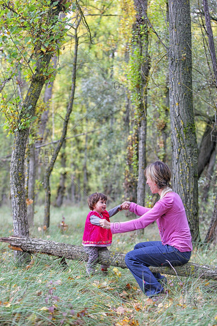 Mother And Daughter Enjoying In The Forest Of Poplars And Pines