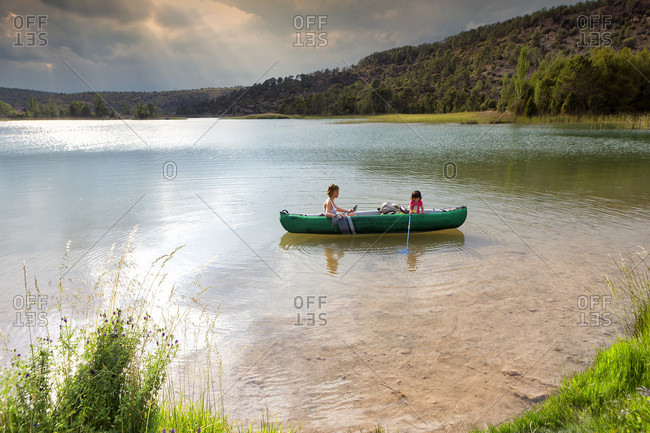 Mother And Daughter On Canoe With Butterfly Nets In Valbona River