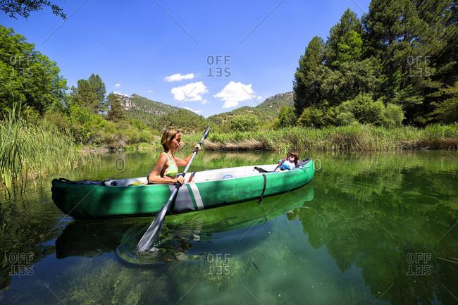 Mother And Daughter Kayaking In Alto Tajo Natural Park, Spain