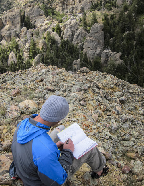 Man Looking At Log Book In Maple Canyon, Utah