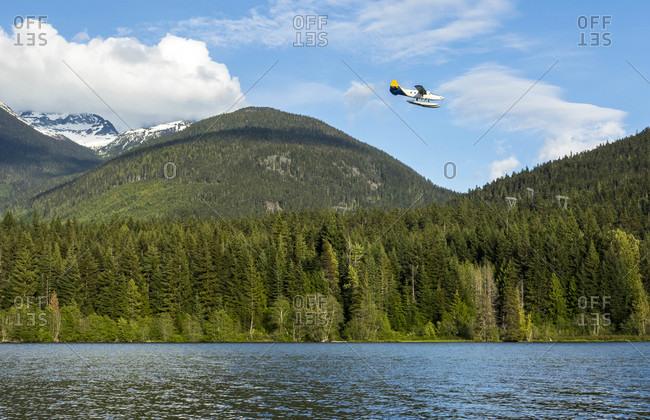 A Seaplane Preparing For Landing On Green Lake In Whistler
