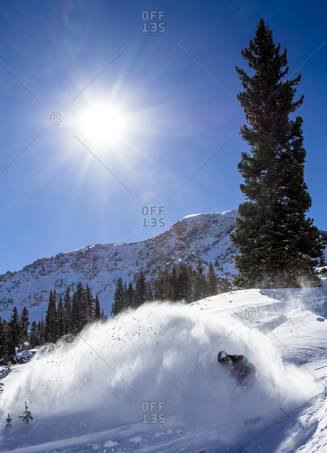 A Man Snowboarding In Little Cottonwood Canyon In Utah