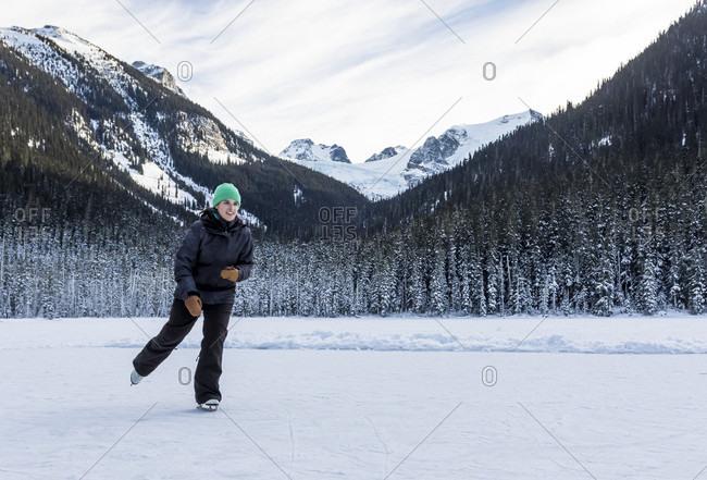 Girl Ice Skating On Joffre Lake In British Columbia