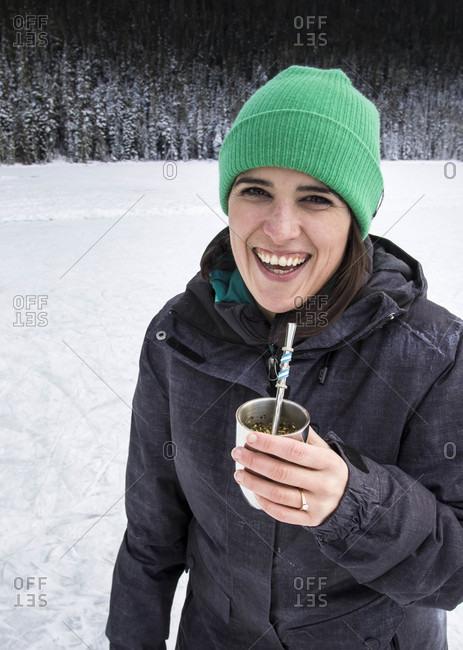 Smiling Girl Drinking Yerba Mate Tea At Joffre Lake