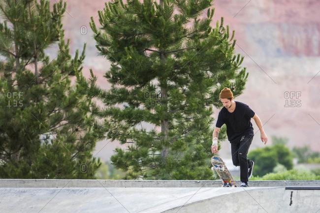 Man With His Skateboard At Rosewood Skatepark