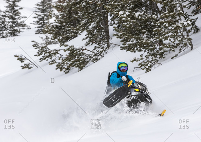 Man Riding A Snowmobile On A Snowy Day On Togwotee Pass In Wyoming