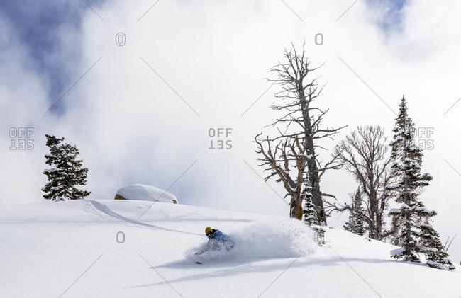 Male Snowboarder Takes A Turn At Brighton Resort In Utah