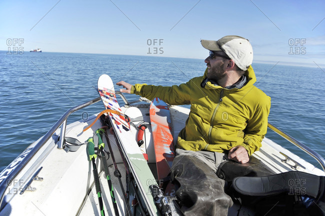 Male Skier On Boat At Augustine Island In Cook Inlet, Alaska