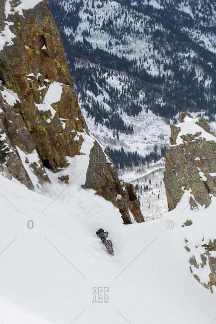 Man Snowboarding On Mountain Slope
