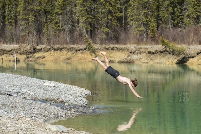 Man Jumping In Green River, Canada