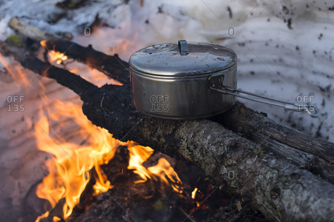 Cooking Food Over A Fire During Winter