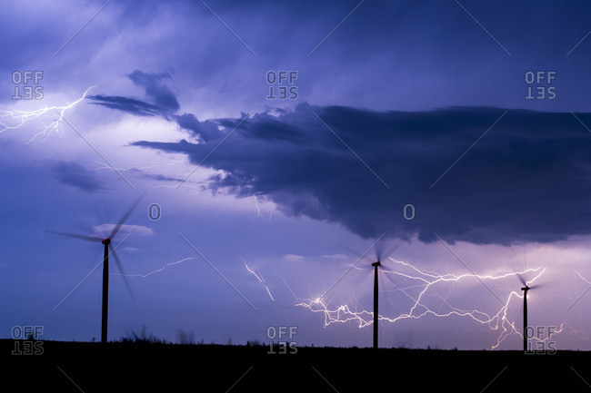 View Of Lightning Storm Behind Wind Turbines In Field Of Illinois