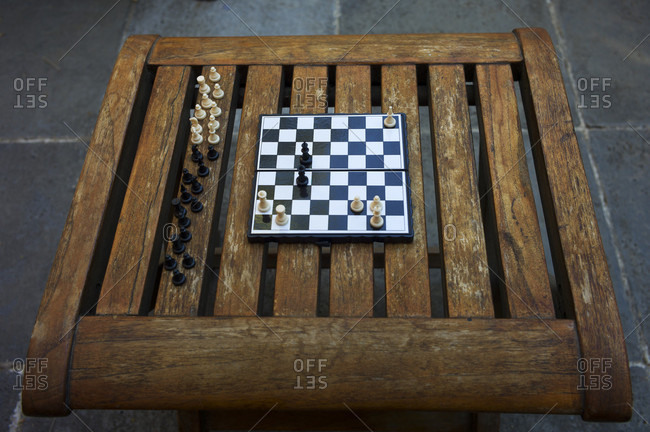 High Angle View Of Chessboard On Wooden Table