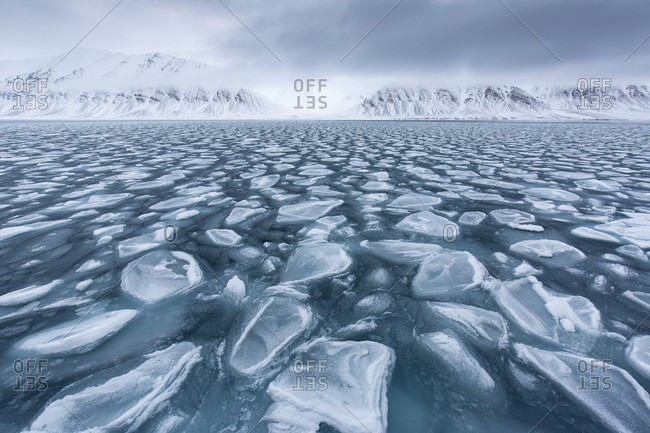 Broken Pack Ice In Arctic Sea With Glacier In The Background In Spitsbergen, Svalbard