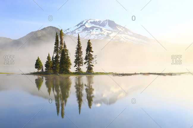 Reflection Of Tree And Mountain In Sparks Lake During Sunrise