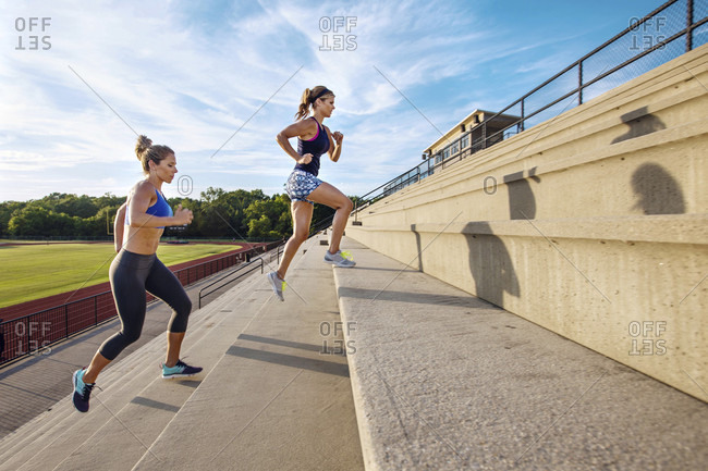 Two Athlete Women Running On Staircase In Stadium